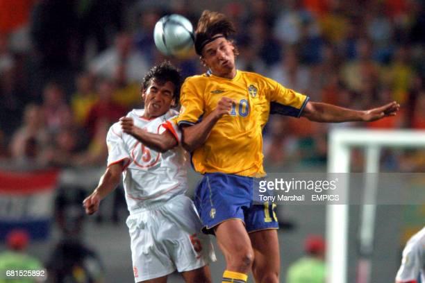 Sweden's Zlatan Ibrahimovic wins the header above Holland's Giovanni van Bronckhorst