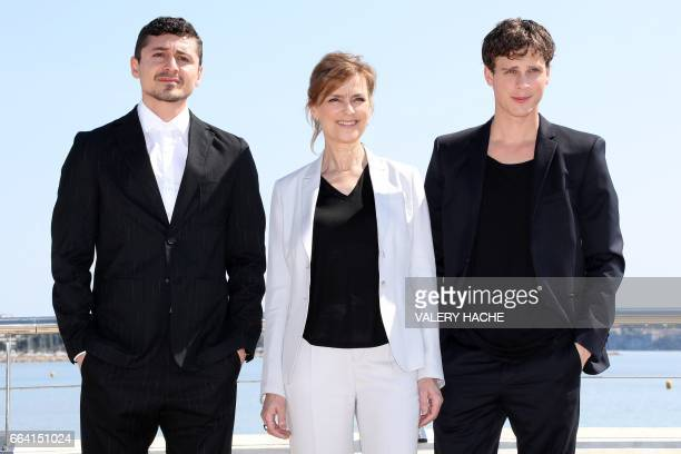 Swedish actors Alexej Manvelov Marie Richardson and Adam Palsson who star in the series 'Before we die' poses during a photocall as part of the MIPTV...