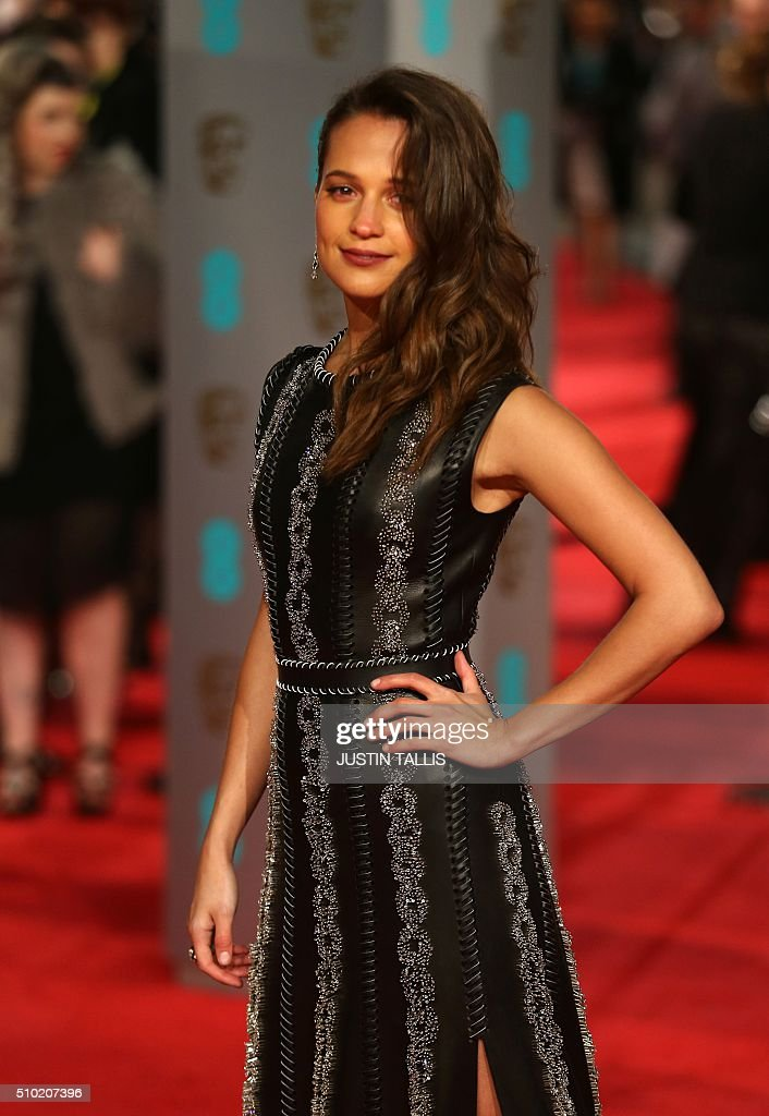 Swedish actress Alicia Vikander poses on arrival for the BAFTA British Academy Film Awards at the Royal Opera House in London on February 14, 2016. TALLIS