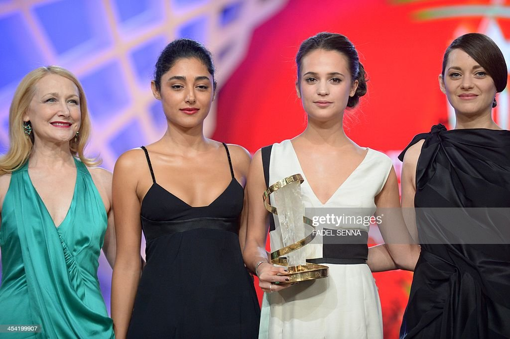 Swedish actress Alicia Vikander (2nd R) receives the prize of the best performance by an actress from French actress Marion Cotillard (R), Iranian actress Golshifteh Farahani (2nd L) and US actress Patricia Clarkson (L) during the closing ceremony of the 13th Marrakech International Film Festival on December 7, 2013 in Marrakech.
