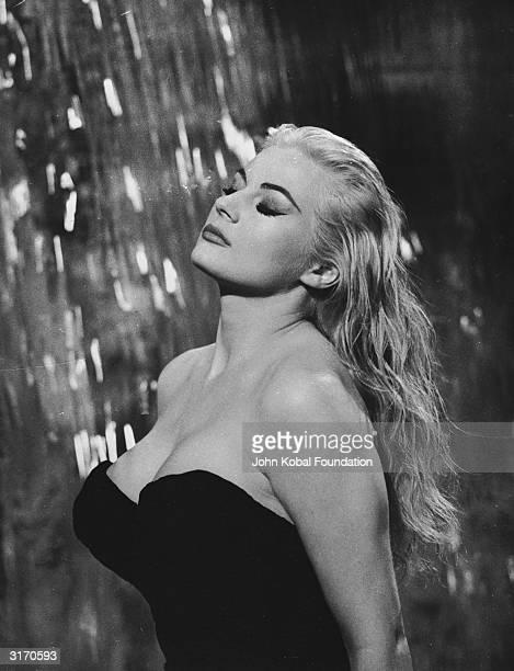 Swedish actress Anita Ekberg plays the glamorous Sylvia in the fountain scene from 'La Dolce Vita' directed by Federico Fellini