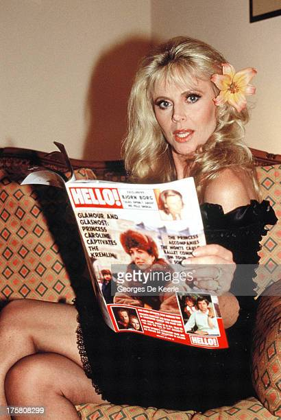 Swedish actress Britt Ekland poses as she holds a copy of 'Hello' magazine on February 23 1989 in London England