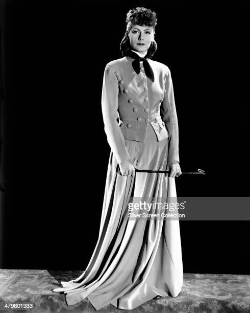 Swedish actress Greta Garbo holding a riding crop in a promotional portrait for 'Anna Karenina' directed by Clarence Brown1935