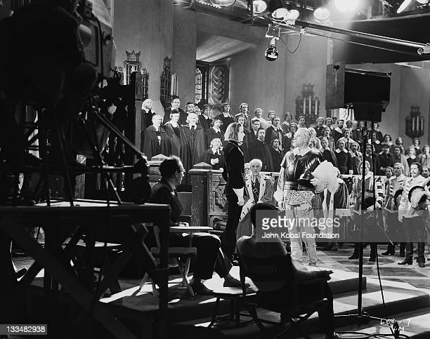 Swedish actress Greta Garbo on the set of the MGM film 'Queen Christina' 25th September 1933 Director Rouben Mamoulian looks on