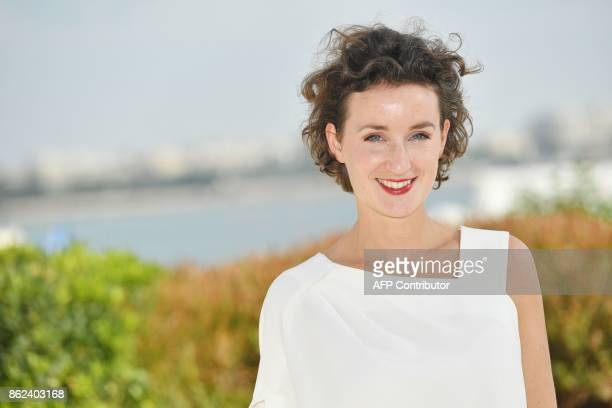 Swedish actress Hedda Rehnberg poses during the MIPCOM trade show in Cannes southern France on October 17 2017 / AFP PHOTO / YANN COATSALIOU