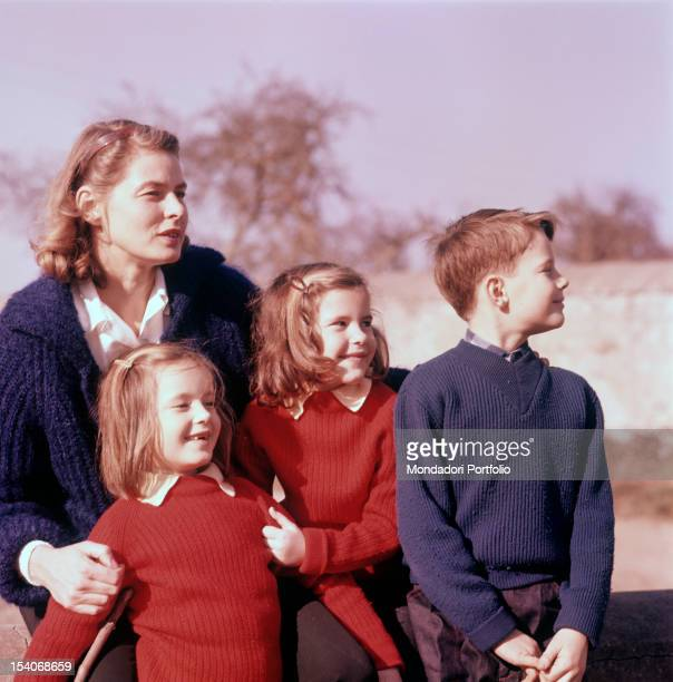 Swedish actress Ingrid Bergman hugging her children Isotta Isabella and Robertino Rossellini 1950s