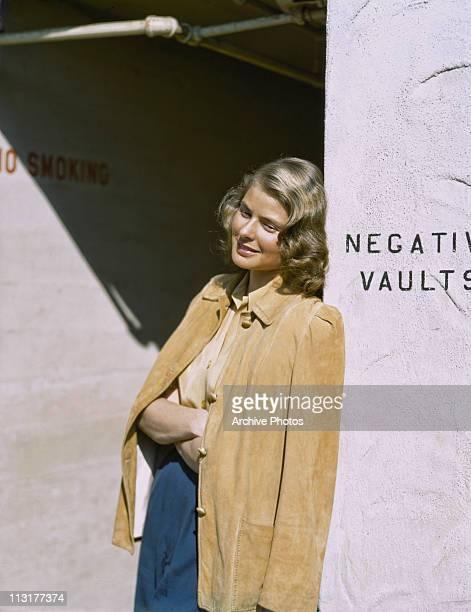 Swedish actress Ingrid Bergman leans against a wall circa 1945