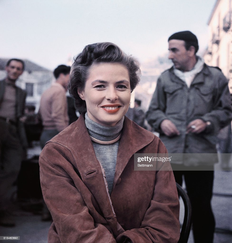 Ingrid Bergman is shown here posing for this photo in between shooting scenes in her latest picture, New Wine, which is being directed by her husband Roberto Rossellini and costars George Sanders.