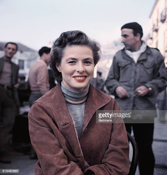 Ingrid Bergman is shown here posing for this photo in between shooting scenes in her latest picture New Wine which is being directed by her husband...