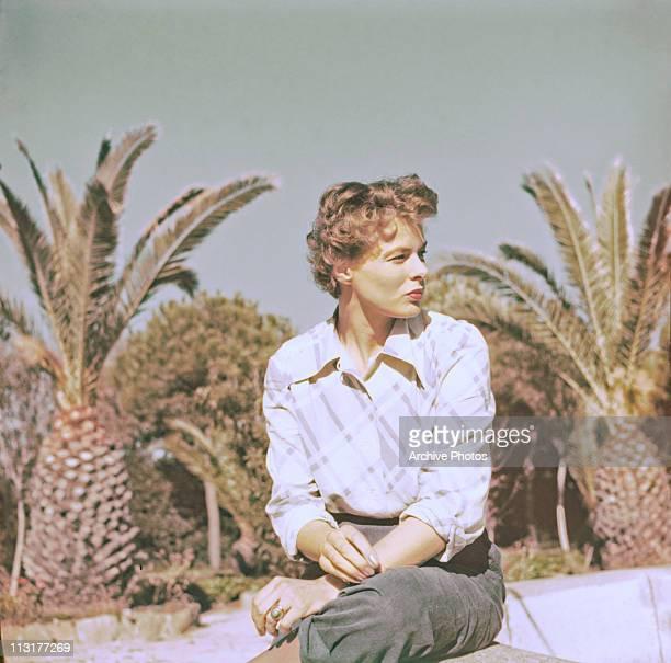 Swedish actress Ingrid Bergman sitting outside in the 1950's