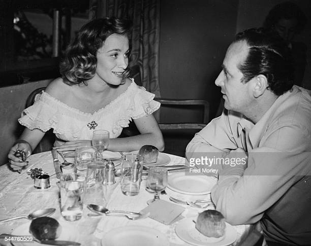 Swedish actress Mai Zetterling and director Edmond Greville eating lunch together during the making of the film 'The Romantic Age' at Denham July...