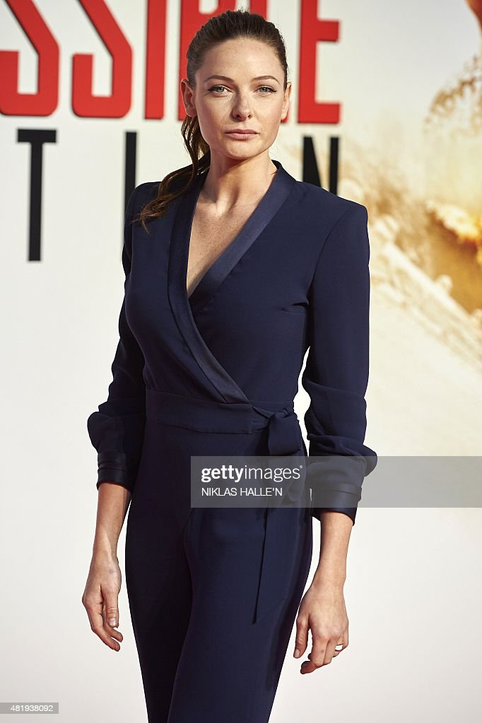 Swedish actress rebecca ferguson poses on the red carpet as she