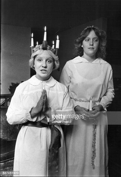 Swedish American 'Sisters' celebrate ste Lucia Day Anne Svensson wears traditional crown of candles and Doriann Nelson JFK junior Credit Denver Post
