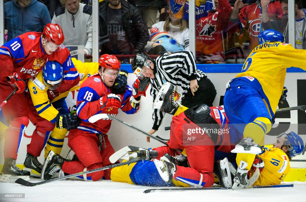 Swedish and Russian players react at the final whistle of the World Junior Hockey Championships semifinal between Sweden and Russia at Malmo Arena in Malmo, Sweden on January 4, 2014. Sweden won 2-1 and plays in the final on January, 5.