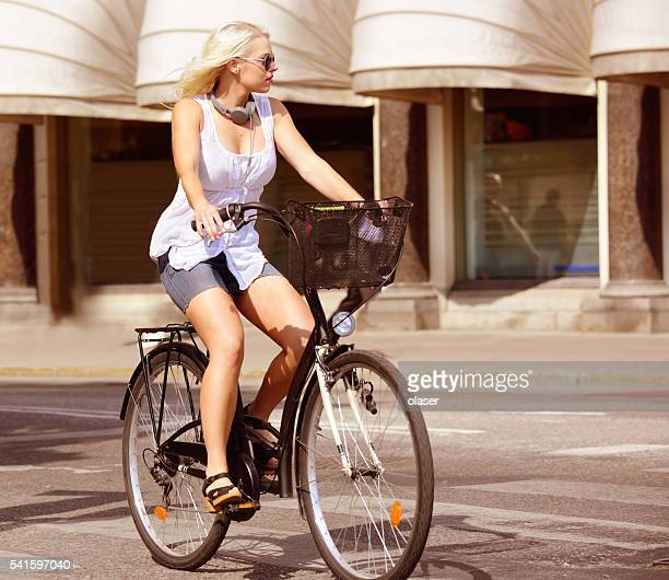 Swedish blonde girl and bicycle in city