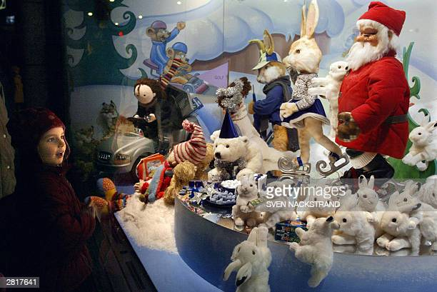 Swedish child looks 16 December 2003 in Stockholm at one of the many windows with Christmas gifts on display in the NK department store AFP PHOTO /...