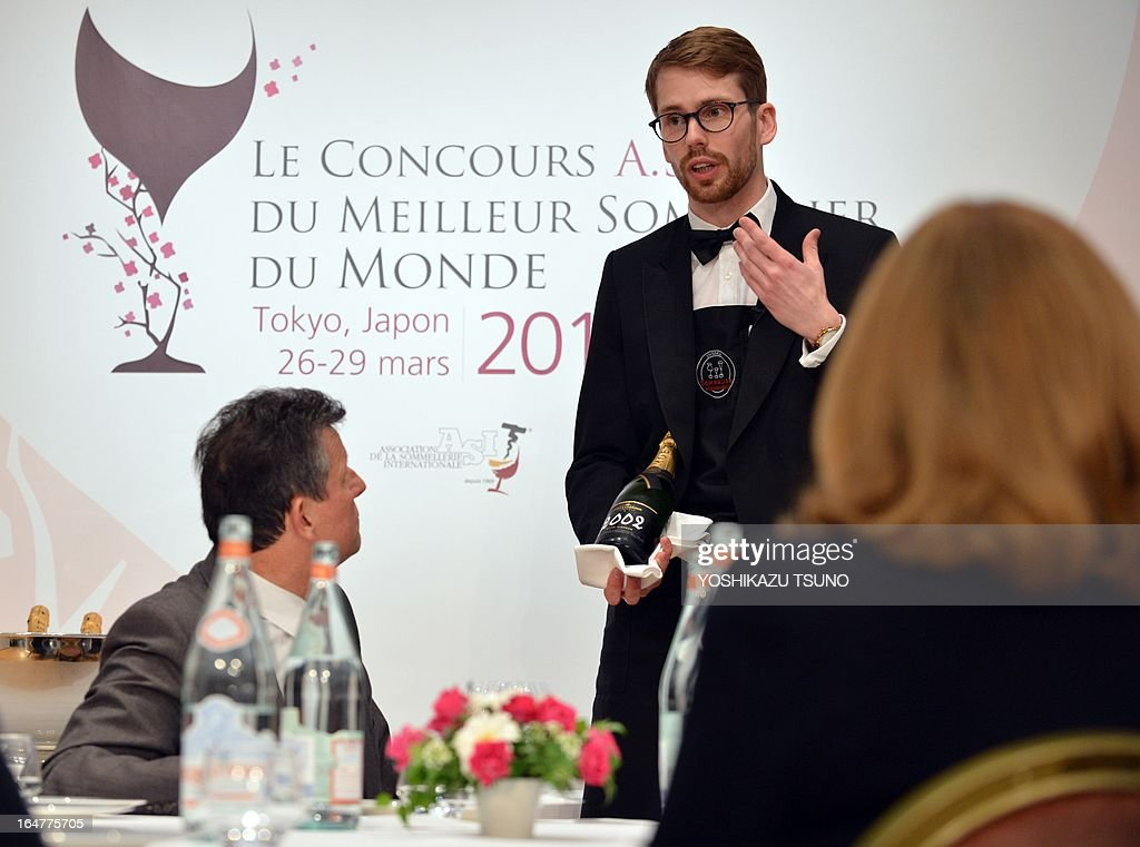 Swedish contestant Arvid Rosengren serves wine to judges during the semi-final of the 14th world sommelier contest in Tokyo on March 28, 2013. Wine waiters of the world gathered in Tokyo for a competition to find the best sommelier in the world. AFP PHOTO / Yoshikazu TSUNO