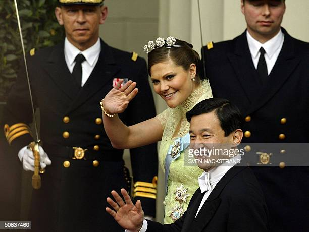 Swedish Crown Princess Victoria and Japanese Crown Prince Nahurito wave as they leave the Cathedral in Copenhagen 14 May 2004 after the wedding of...