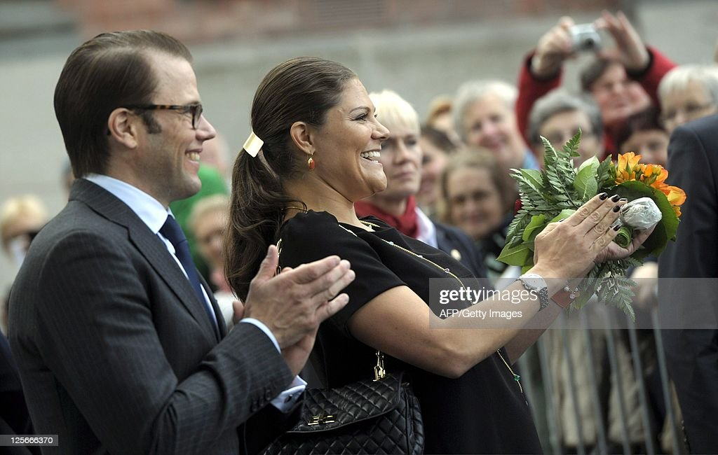 Swedish Crown Princess Victoria (R) and Prince Daniel greet a crowd at a marketplace in Turku on September 20, 2011. The Swedish princess and her husband are on a two-day visit to Turku, the 2011 European Culture Capital.