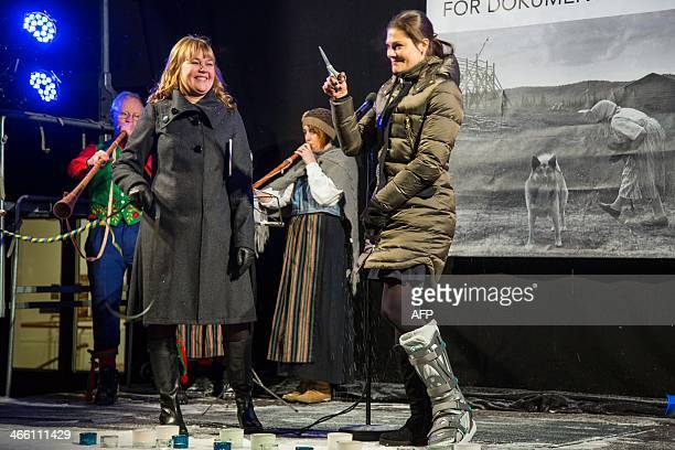 Swedish Crown Princess Victoria raises the scissors after cutting the tape for the opening of a center for documentary photography in Umea on January...