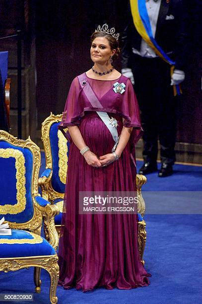 Swedish Crown Princess Victoria waits to leave the stage after the 2015 Nobel prize award ceremony at Stockholm Concert Hall on December 10 2015...