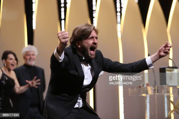TOPSHOT Swedish director Ruben Ostlund asks the audience to roar after he was awarded with the Palme d'Or for the film 'The Square' on May 28 2017...