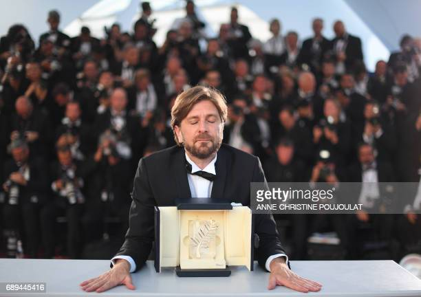 TOPSHOT Swedish director Ruben Ostlund attends on May 28 2017 a photocall after he won the Palme d'Or for 'The Square' at the 70th edition of the...