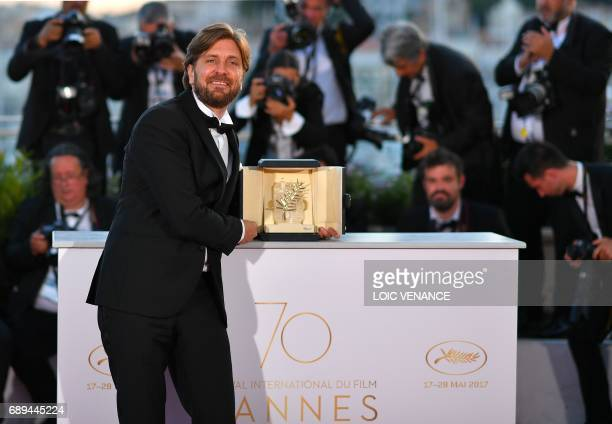 Swedish director Ruben Ostlund poses with his trophy during a photocall on May 28 2017 after he won the Palme d'Or for his film 'The Square' at the...