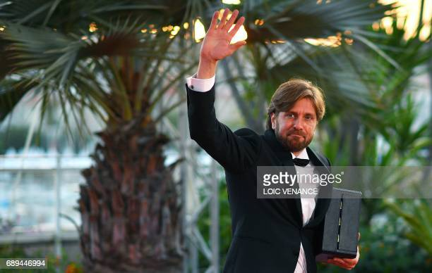 Swedish director Ruben Ostlund waves as he arrives on May 28 2017 to attend a photocall after he won the Palme d'Or for his film 'The Square' at the...