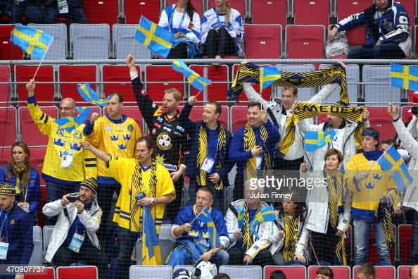 Swedish fans wave flags during the Men's Ice Hockey Semifinal Playoff against Finland on Day 14 of the 2014 Sochi Winter Olympics at Bolshoy Ice Dome...