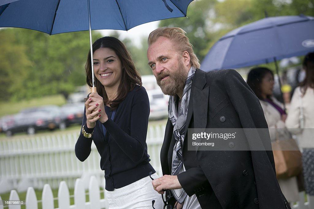 Swedish fashion designer Johan Lindeberg, right, arrives during the Sentebale Royal Salute Polo Cup at the Greenwich Polo Club in Greenwich, Connecticut, U.S., on Wednesday, May 15, 2013. Prince Harry of Wales' visit is part of a week-long U.S. tour that also includes stops in Washington, Colorado and New York. Photographer: Scott Eells/Bloomberg via Getty Images