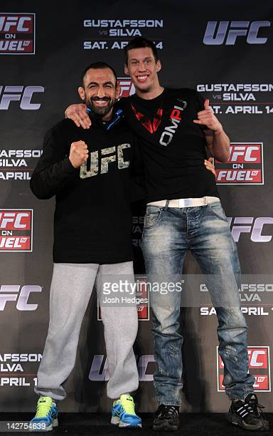 Swedish fighters Reza Madadi and Magnus Cedenblad pose for photos during the UFC on Fuel TV prefight press conference at Clarion Hotel on April 12...