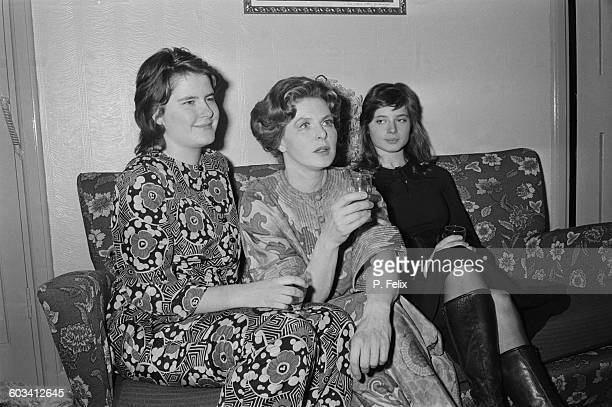 Swedish film and theatre actress Ingrid Bergman sits with her twin daughters actress Isabella and academic Isotta Ingrid after Bergman's performance...
