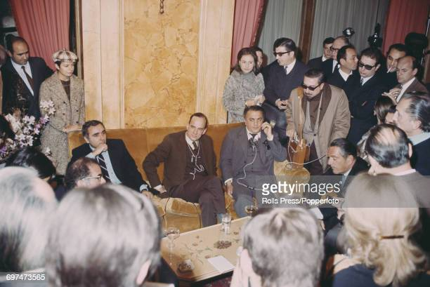 Swedish film director Ingmar Bergman pictured seated in centre with Italian film director Federico Fellini at a press conference in Rome Italy on 5th...