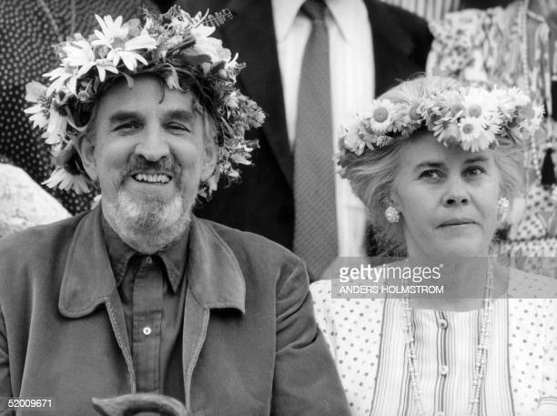 Swedish filmmaking legend Ingmar Bergman and his wife Ingrid smile to their friends 14 July 1988 in their house on the Baltic Sea island of Faro...