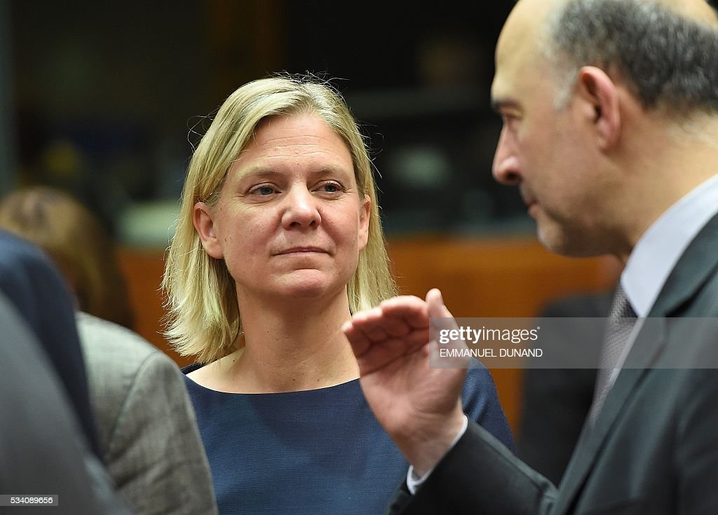 Swedish Finance Minister Magdalena Andersson (L) and European Commissioner for Economic and Financial Affairs, Taxation and Customs Pierre Moscovici attend an Economic and Financial (ECOFIN) Affairs Council meeting at the European Council, in Brussels, on May 25, 2016. / AFP / EMMANUEL