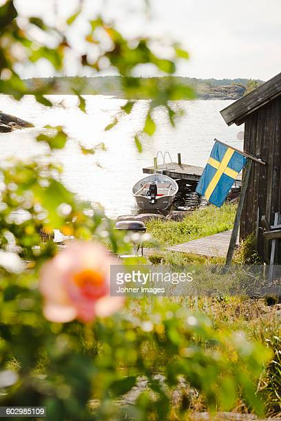 Swedish flag and boats moored at coast