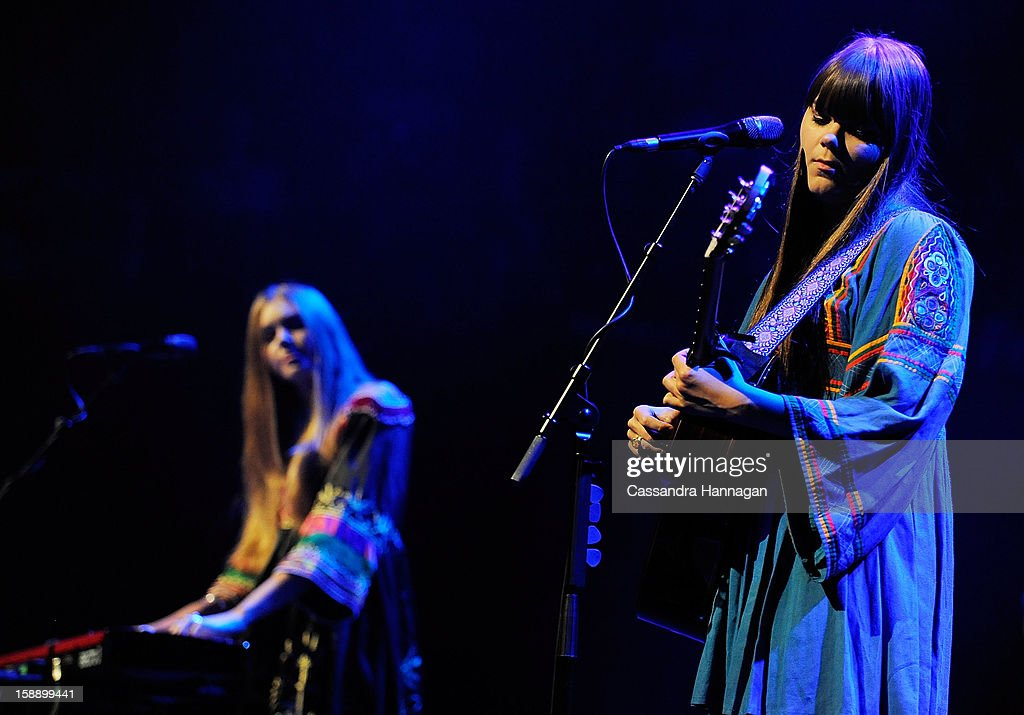 Swedish folk duo Klara Soderberg and Johanna Soderberg (L) of First Aid Kit perform for fans at Sydney Opera House on January 3, 2013 in Sydney, Australia.