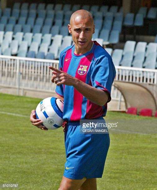 Swedish football player Henrik Larsson wears Barcelona club jersey during his official presentation after he was signed for one year with a...