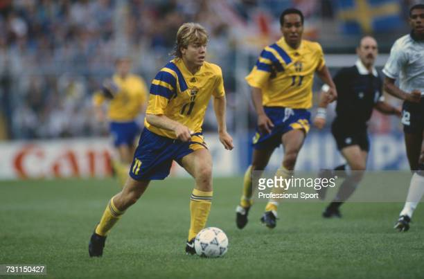 Swedish footballer Tomas Brolin makes a run with the ball as teammate Martin Dahlin adds support during the group 1 match between Sweden and England...