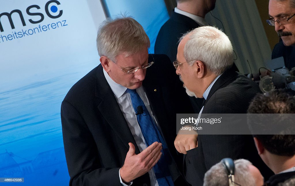 Swedish Foreign Minister <a gi-track='captionPersonalityLinkClicked' href=/galleries/search?phrase=Carl+Bildt&family=editorial&specificpeople=3972090 ng-click='$event.stopPropagation()'>Carl Bildt</a> and Iranian Foreign Minister Mohammed Javad Zarif meet during the 50th Munich Security Conference (MSC) in the Bayerischer Hof hotel on February 2, 2014 in Munich, Germany. The Munich Security Conference is to open with officials, ministers, top military brass and experts discussing the world's hot button foreign policy issues at the three-day annual get-together.
