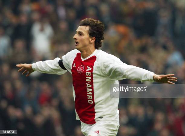 Swedish forward Zlatan Ibrahimovic of Ajax Amsterdam celebrates after scoring against Vitesse Arnhem during their Dutch premier league match in...