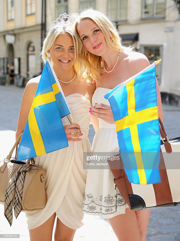 swedish-girls-wave-flags-outside-the-royal-palace-ahead-of-the-of-picture-id170157147