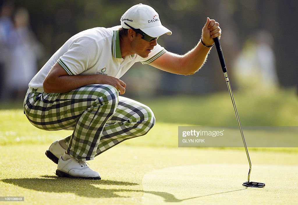 Swedish golfer Henrik Stenson lines up his putt on the 1st green during the second day of the PGA Championship on the West Course at Wentworth, England, on May 21, 2010.