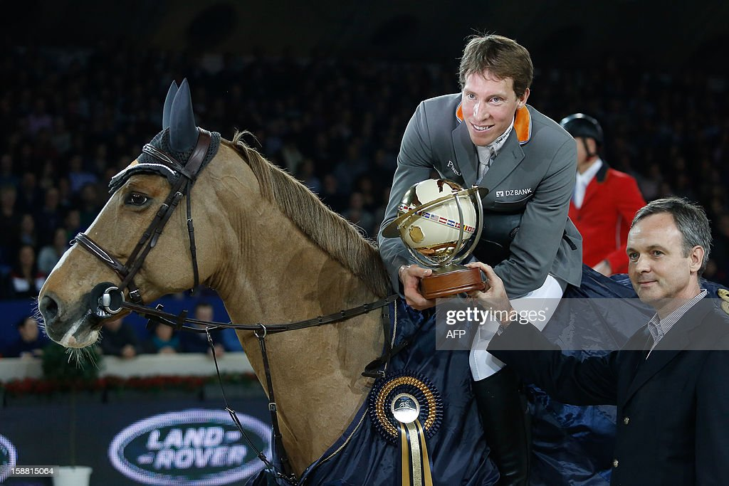 OUT +++++ Swedish Henrik Von Eckermann poses with his trophy on Gotha after winning the 'Memorial Eric Wauters' equestrian FEI World Cup Jumping competition, on December 30, 2012, in Mechelen. BELGA / AFP PHOTO BRUNO FAHY
