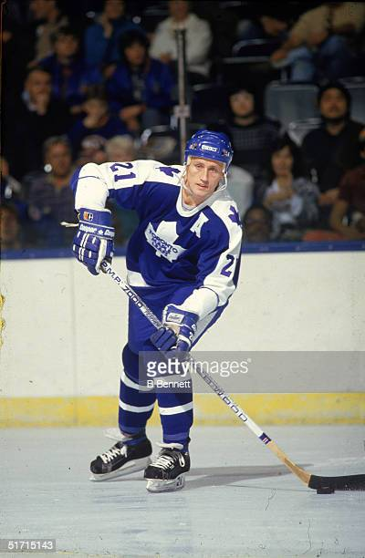 Swedish hockey player Borje Salming defenseman for the Toronto Maple Leafs skates with the puck in a game against the New York Islanders at Nassau...