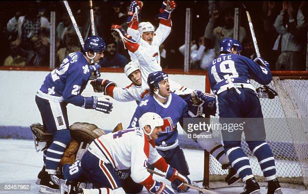 Swedish hockey player Mats Naslund of the Montreal Canadiens and Canadian teammate Mario Tremblay celebrate a goal versus the Quebec Nordiques...