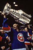Swedish ice hockey player Bob Nystrom of the New York Islanders celebrates his team's third consectutive Stanley Cup victory by raising the cup aloft...