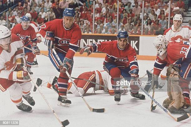 Swedish ice hockey player Hakan Loob of the Calgary Flames tries to evade the Montreal Canadiens during a game in the Stanley Cup finals Calgary...