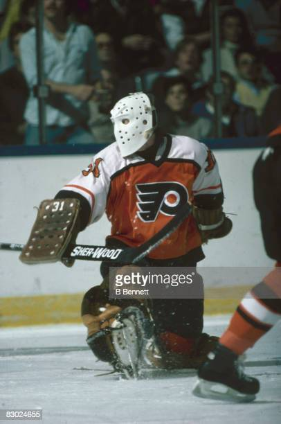 Swedish ice hockey player Pelle Lindbergh goalkeeper for the Philadelphia Flyers sticks out his leg to make a save during a game early 1980s